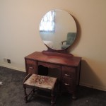 "Lot # 16: Vanity set, base is 45"" X !9"" X 29""  Mirror is blurry.  Sold with matching dresser only."