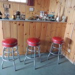 Lot # 7: Three VERY COOL 1950s   Chrome bar stools.