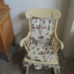 LOT # 2: Antique rocker with pressed seat.