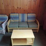 "LOT # 53: Wicker 63"" sofa and 18"" X 30 coffee table. may bid separate or together with Lot # 51."
