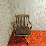 LOT # 15: Really cool antique wooden banker's chair. Marked Murphy 4415