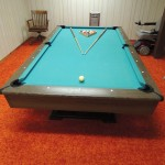 Lot # 16: Nice quality 4' X 8' Centurion pool table. Three piece slate and really good rails.  Comes with the original manual showing how to assemble/dis-assemble it. Some cosmetic issues, but a nice table. Equipment included.