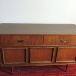 "LOT # 20: Nice quality dresser, two doors, two drawers (one with dividers for small items). Dovetailed front and back.  18"" X 52"" X 31"""