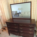 "LOT # 4: Solid mahogany eight drawer dress with dovetailed corners.  19"" X 54"" X 34"" tall with 30"" X 40"" mirror. Many small surface scratches (needs Formby's)"