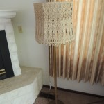 "Lot # 6:   Floor lamp, 56"" tall with hand crocheted shade and three way light."